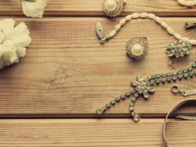 antique vintage silver jewellery on wooden table